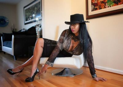 glamour model posing on chair