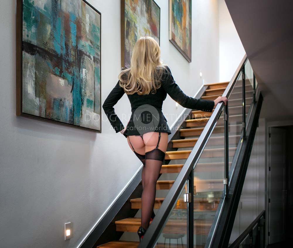 glamour model photographed walking on stairs