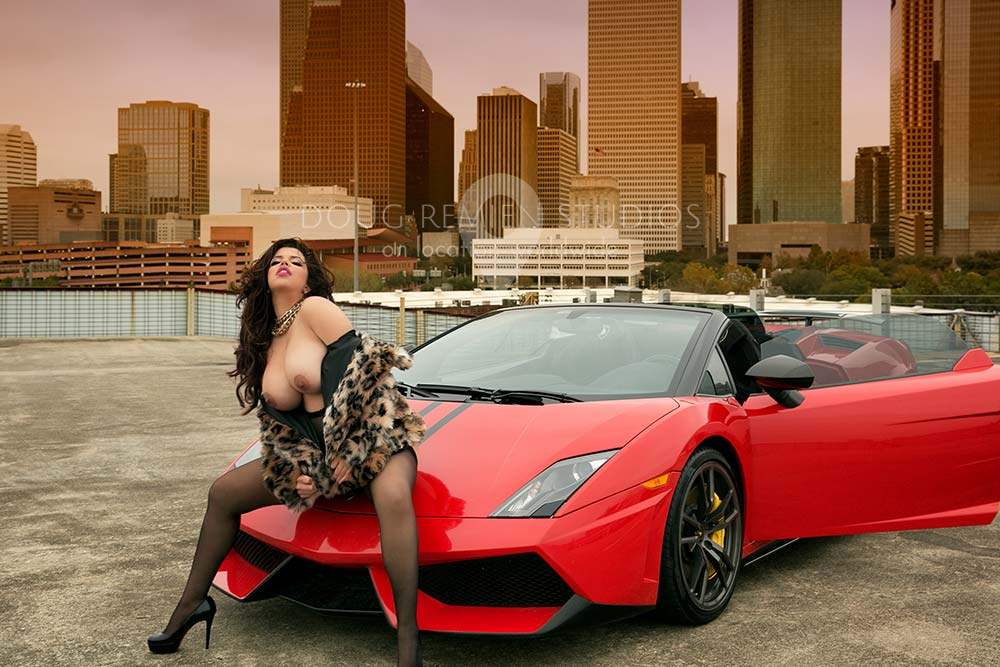 glamour model photographed with red Lamborghini and Houston skyline