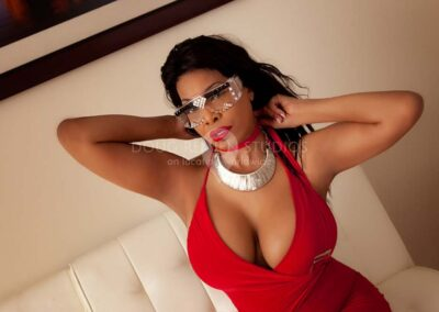 african american glamour model in red dress in Detroit, Michigan