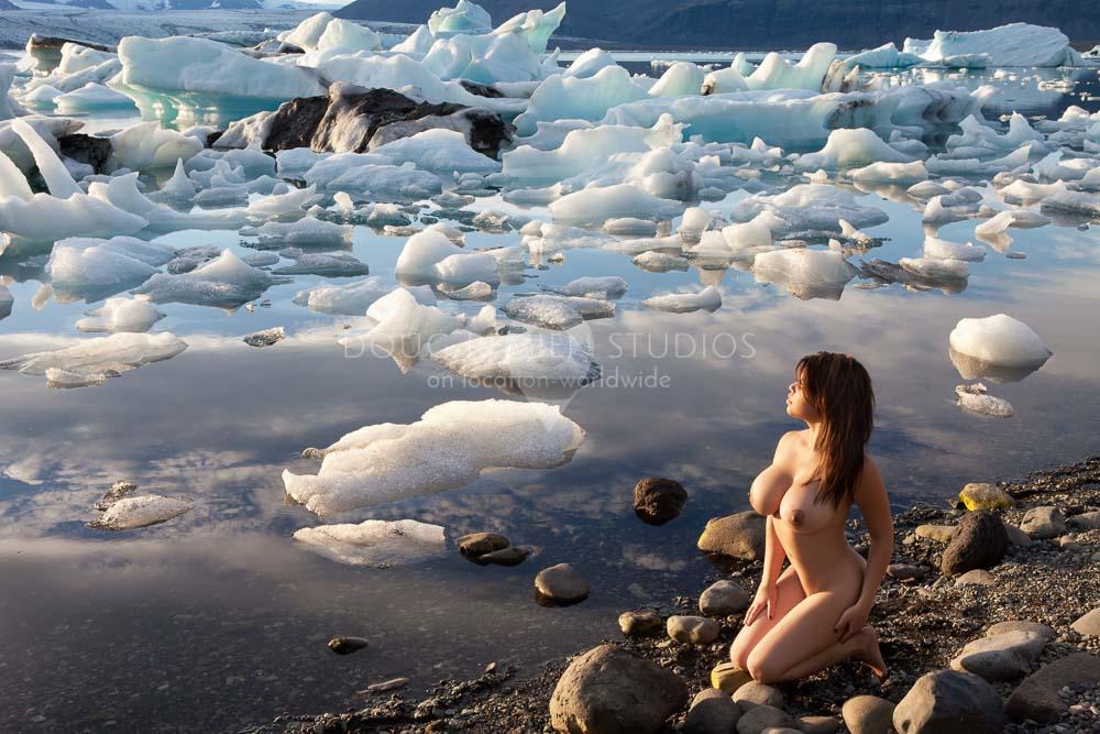 nude glamour model at Jokulsarlon Glacier Lagoon, Iceland