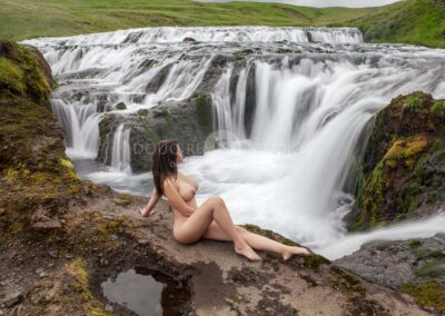 nude glamour model at waterfall in River, Iceland