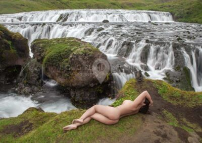 nude glamour model at waterfall in Skoga River, Iceland