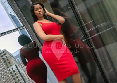 african american glamour model in red dress