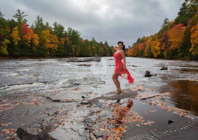 glamour model in red dress at Tahquamenon Falls State Park, Michigan
