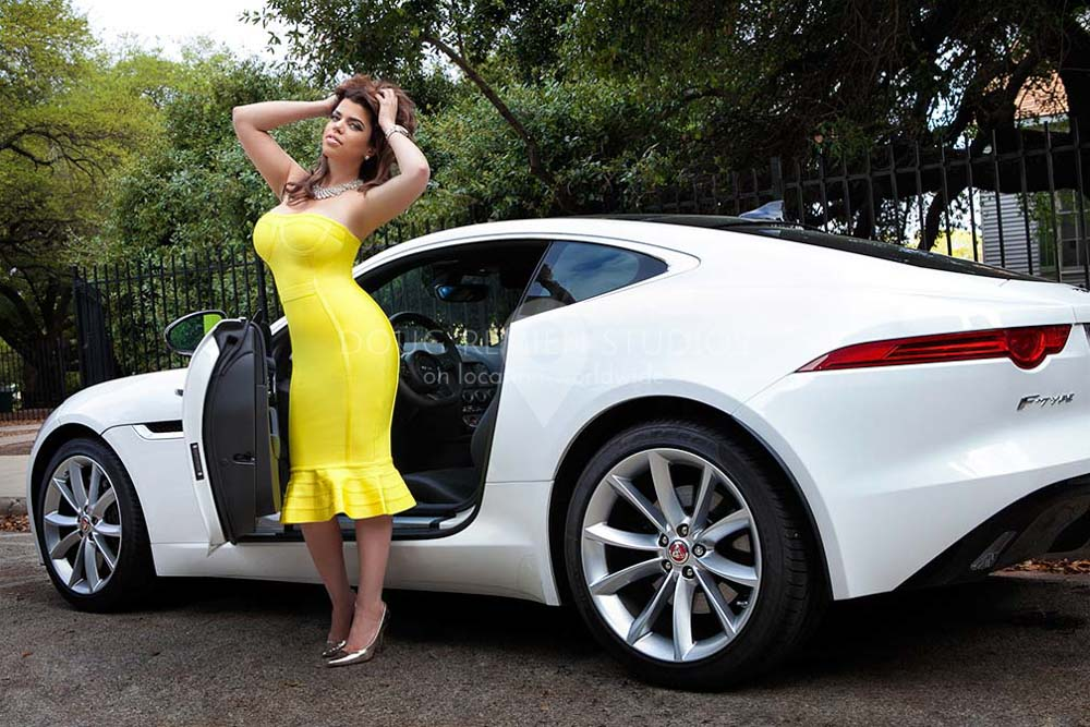 glamour car model in yellow dress with white Jaguar