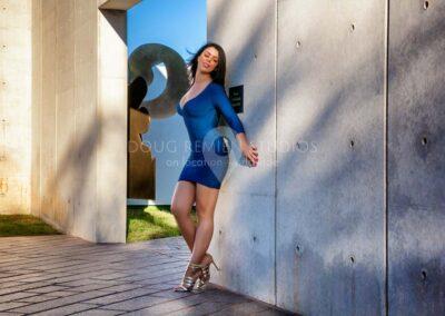 glamour model in blue dress in Cullen Sculpture Garden, Houston, Texas