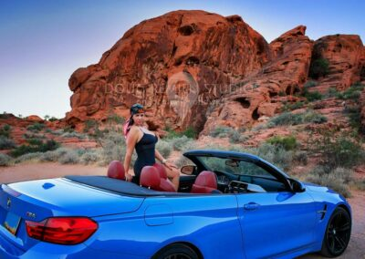 glamour model at Valley of Fire State Park, Nevada with blue BMW