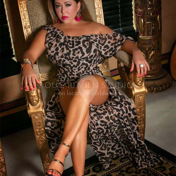 brunette glamour model in leopard skin dress