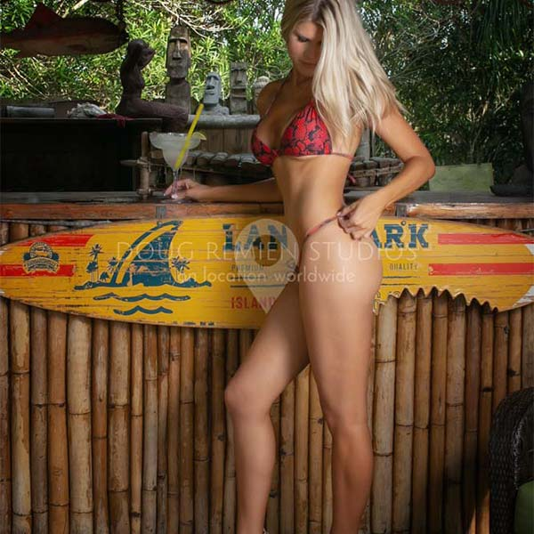 blonde glamour model in bikini in tiki bar