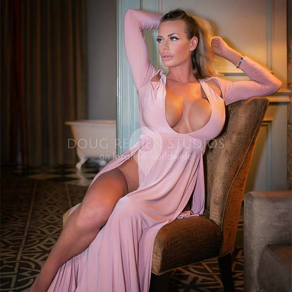 large breasted blonde glamour model in pink dress