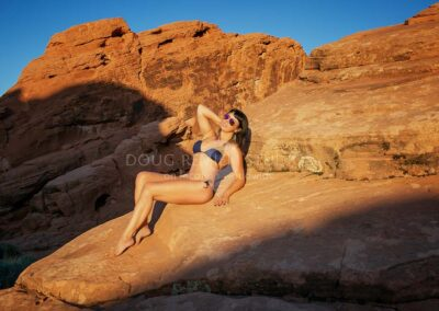 glamour model posing outdoors in swimsuit