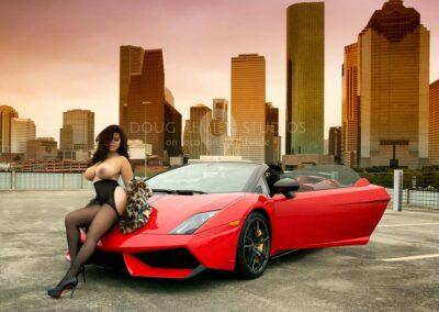 nude glamour model posing with Lamborghini and Houston skyline