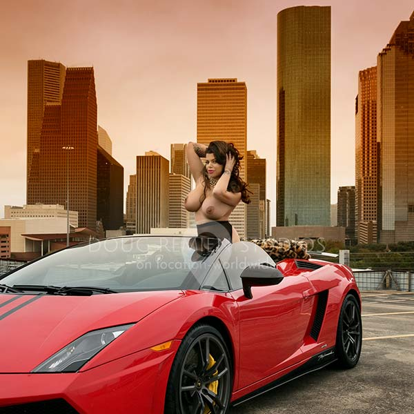 nude glamour model with red Lamborghini and Houston skyline