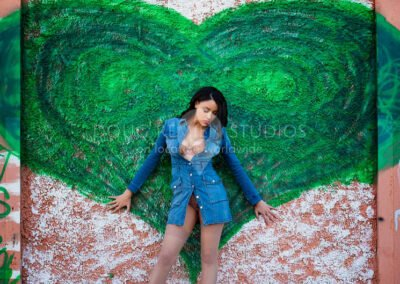 glamour model posing with wall mural art